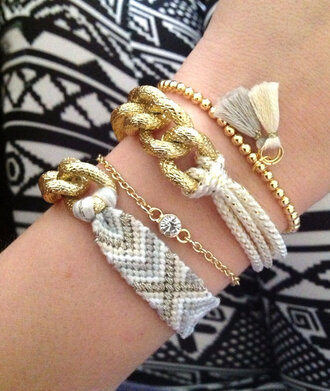 jewels gold chain knot rope grey gray white cream aztec tribal pattern gold bead tassel rhinestones diamonds chain curb chain friendship bracelet bracelets