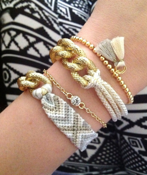 jewels gold rope gold chain knot grey white cream aztec tribal pattern bead tassels rhinestone diamonds chain curb chain friendship bracelet bracelets