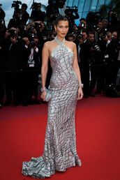 dress,gown,prom,silver,metallic,long dress,bella hadid,model,red carpet dress,red carpet,cannes,backless,backless dress,bag,clutch