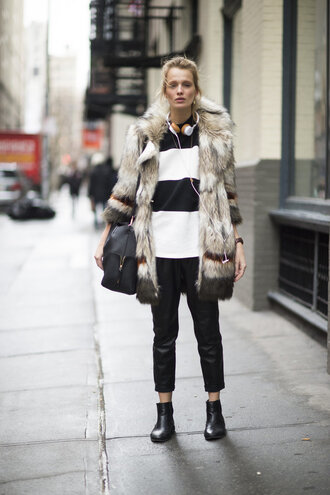 sweater stripes black and white pants boots coat fur fur coat streetstyle fashion week 2016 ny fashion week 2016 big fur coat striped top cropped pants black pants black leather pants leather pants bag black bag flat boots black boots