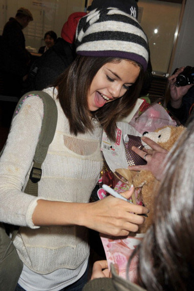 white hat selena gomez grey hat sweater