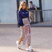 top,shirt,midi skirt,pleated skirt,logo,sneakers,sunglasses