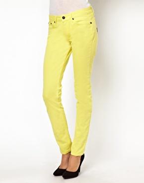 Religion fluro skinny jeans at asos