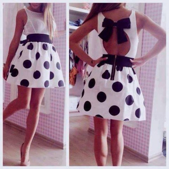 dress polka dots black and white sun dress bow big bow cut-out open back backless cute skirt shirt lace dress polka dots dress cute dress bow tie dress polka dress cute bow tie black white fashion dots cupcake dress little black dress polka dot skirt bare back white dress high waisted skirt skater skirt high heels nude black skater dress
