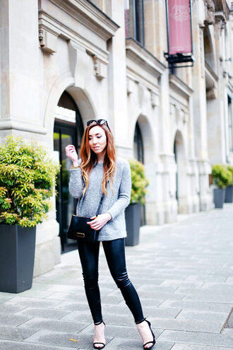 flirting with fashion blogger leather leggings black sandals grey sweater
