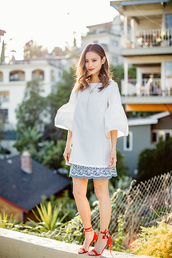 cardigan,sandals,skirt,jamie chung,spring outfits,mini skirt,tunic,blogger,shoes,red heels,white blouse,bell sleeves,blue dress,bell sleeve top