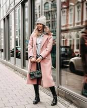 coat,pink coat,long coat,patent shoes,black leggings,ankle boots,bag,grey hoodie,hat,knit