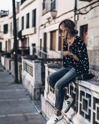shirt tumblr black shirt stars necklace watch silver watch silver necklace silver jewelry jewels jewelry denim jeans blue jeans ripped jeans sneakers white sneakers low top sneakers bag black bag