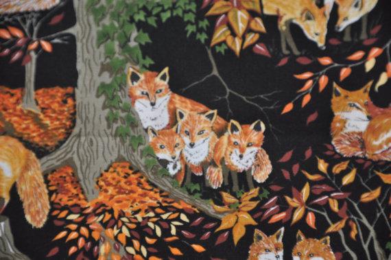 Fox fabric orange fox community print on black par for Fox print fabric