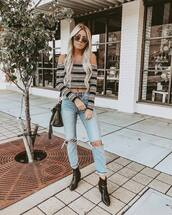 sweater,off the shoulder top,stripes,knit,knitwear,ankle boots,jeans,ripped jeans,high waisted jeans,shoulder bag,sunglasses