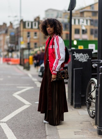 top maxi fashion week street style fashion week 2016 fashion week london fashion week 2016 maxi skirt skirt gold skirt pleated skirt brown top asymmetrical asymmetrical top jacket baseball jacket red jacket bag animal print bag animal print streetstyle