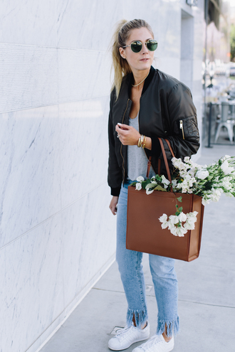 devon rachel blogger sunglasses black bomber jacket grey top brown bag frayed denim white sneakers round sunglasses