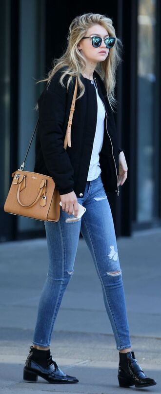 jacket bomber jacket black bomber jacket black jacket gigi hadid style gigi hadid celebrity style celebrity model off-duty bag boots streetstyle black boots ankle boots white top sunglasses mirrored sunglasses jeans