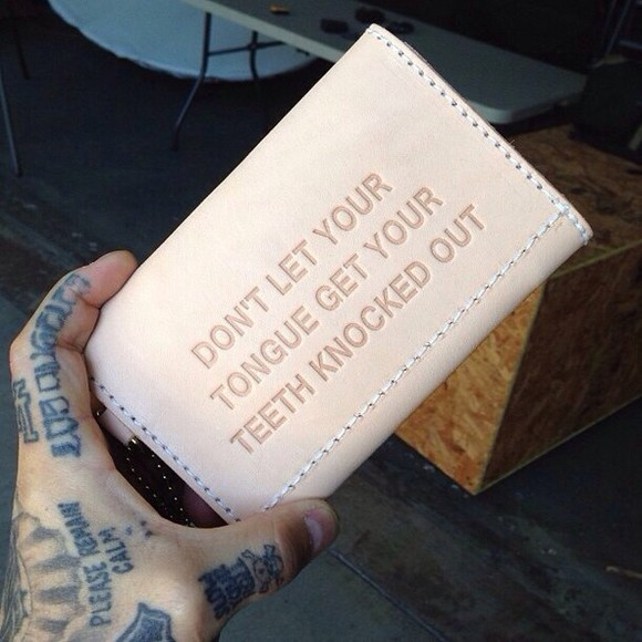 teeth tongue bag knocked out wallet cream words