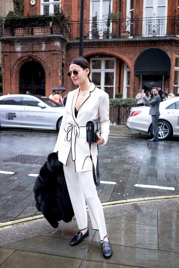 fashion vibe blogger sunglasses black and white white jacket black top white pants black bag fur coat black coat black flats office outfits