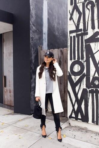 coat tumblr white coat denim jeans black jeans frayed denim pumps hoodie cap baseball cap bag