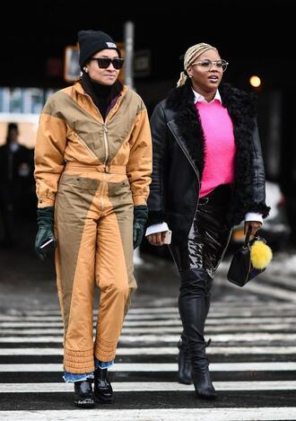 jumpsuit nyfw 2017 fashion week 2017 fashion week streetstyle scarf sweater pink sweater neon pink jacket black jacket leather jacket black leather jacket shearling jacket black shearling jacket skirt midi skirt vinyl skirt vinyl boots black boots sunglasses beanie leather gloves gloves bag black bag curvy plus size
