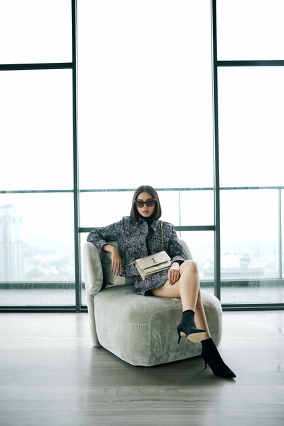 olivia lazuardy blogger sunglasses top skirt bag shoes winter outfits ysl bag boots ankle boots