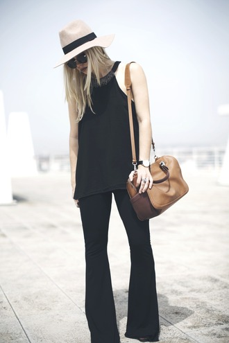 room91 blogger hat black top flare pants black pants leather bag