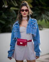bag,belt bag,denim jacket,cropped denim jacket,burgundy,dress,white dress,short dress,sunglasses