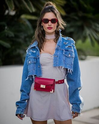 bag belt bag denim jacket cropped denim jacket burgundy dress white dress short dress sunglasses