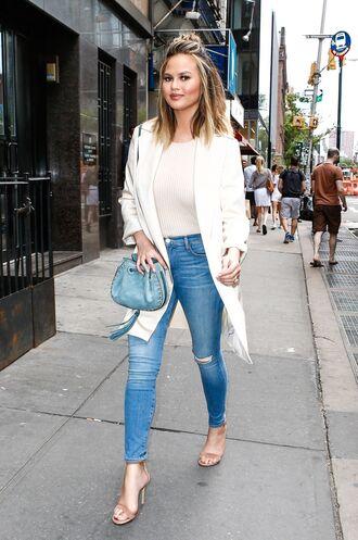 jeans top chrissy teigen sandals purse coat
