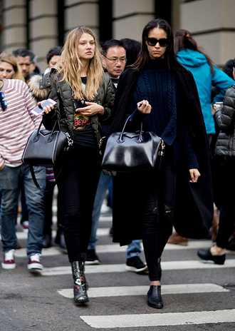 coat nyfw 2017 fashion week 2017 fashion week streetstyle black coat sweater black sweater cable knit blue sweater bag black bag denim jeans black jeans skinny jeans boots black boots ankle boots silver shoes metallic metallic shoes jacket army green jacket sunglasses