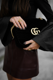 jewels,tumblr,ring,gold jewelry,jewelry,top,black top,bell sleeves,skirt,burgundy,burgundy skirt,leather skirt,gucci,gucci bag,nail polish,nails,dark nail polish