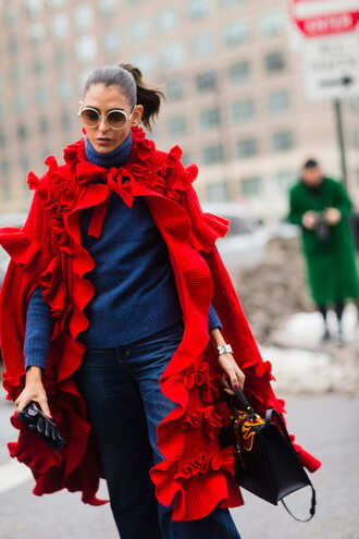 cardigan nyfw 2017 fashion week 2017 fashion week streetstyle red cardigan ruffle sweater blue sweater turtleneck turtleneck sweater denim jeans blue jeans bag black bag sunglasses round sunglasses leather gloves gloves