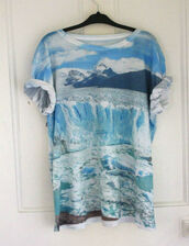 shirt,white,ocean,mountain,blue,t-shirt,wave,clear,clouds,tumblr,urban outfitters,print,landscape,ice,graphic print,glacier,glaciers,graphic tee,hipster,dope,fashion,photography,blue shirt,pretty ocean blue,mountains,blue tumblr ocean unique,rolled sleeves,natural,oversized t-shirt,loose tshirt,scoop neck,low scoop neck,winter outfits,cold,breeze,oversized,pale,tees,clothes,vintage,summer outfits,light blue,pretty,cool shirts,sky,fullprint,boho,hippie,glacier shirt,printed t-shirt,nature,cuffed sleeves,streetwear,printed top,sea,top
