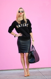 fashion addict,blogger,sweater,quote on it,leather skirt,blonde hair,black bag,sports sweater,black sweater,graphic sweatshirt,sweatshirt,black leather skirt,black skirt,pencil skirt,sunglasses,pointed toe pumps,pumps,high heel pumps,fall outfits,casual chic