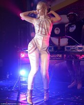 jeans,jumpsuit,iggy azalea,white,white jumpsuit,silk,cut-out,bodycon,cut out bodycon,music,performance,tight,shape,blonde hair,platinum,cute,sexy,sleeveless,concert,tattoo