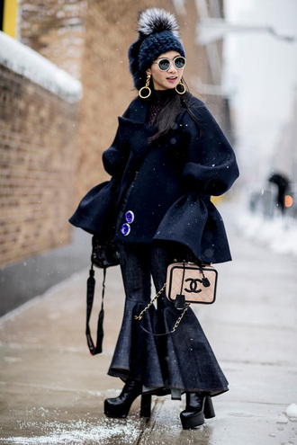 jacket tumblr nyfw 2017 fashion week 2017 fashion week streetstyle black jacket bell sleeves beanie pom pom beanie black beanie bag chanel chanel bag denim jeans kick flare boots black boots high heels boots platform boots sunglasses earrings jewels jewelry gold jewelry