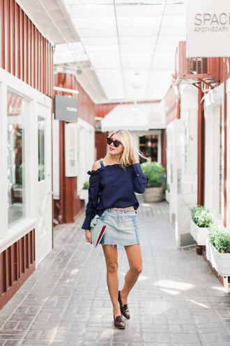 modern ensemble blogger blouse skirt shoes belt sunglasses bag clutch loafers blue top mini skirt