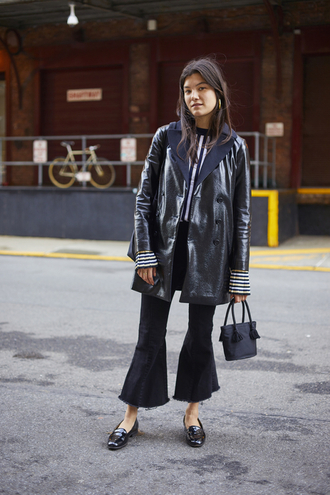 jeans leather coat nyfw 2017 fashion week 2017 fashion week kick flare cropped jeans black jeans coat black coat sweater striped sweater bell sleeves bell sleeve sweater bag black bag shoes black shoes black loafers loafers