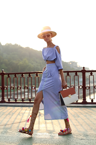 tina sizonova blogger blouse skirt bag shoes midi dress striped dress slit dress cut out shoulder three-quarter sleeves straw hat white sunglasses sunglasses belted dress belt pom pom sandals sandals flat sandals handbag summer dress summer outfits pocket dress