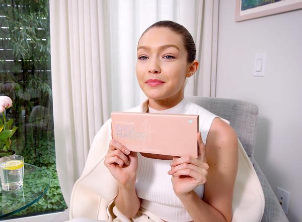 top white white top make-up gigi hadid model makeup bag