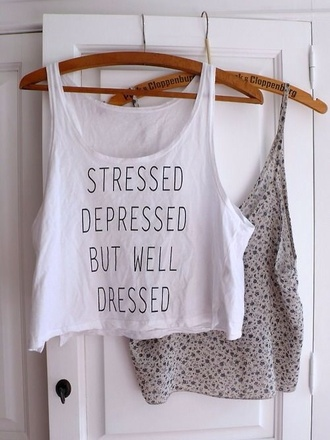 tank top stressed depressed but well dressed floral tank top tumblr crop tops shirt t-shirt white summer outfits crop tops stressed depressed but well dressed print shirt white white tank quote on it hipster blouse quote on it top well dressed tank top t-shirt stressed depressed celebrity name white top quote on it brandy melville whiteshirt white t-shirt
