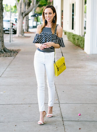 blouse striped top striped blouse black and white top off the shoulder cold shoulder striped off the shoulder top jeans white jeans bag yellow bag shoulder bag sandals white sandals strappy heels streetstyle top cold shoulder top white pants white high heels skinny pants