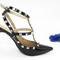 Black rockstud high heel pumps