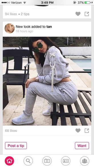 jumpsuit sweater grey fashion kylie jenner luxury hoodie kendall and kylie jenner kardashians grey sweater sunglasses green sunglasses shirt lace up lace up jumper shoes sweatpants winter sweater fall sweater cropped sweater watch accessories outfit outfit idea cute outfits spring outfits jumper white glasses hot tan pants tracksuit joggers grey trackpants keeping up with the kardashians top knot crop tops leggings jersey print sweats
