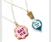 jewels,alice in wonderland,alice,wonderland,cool,necklace,film,eat me,drink me,beautifull,cute,pinky blue,funny,disney,drink,eat,food