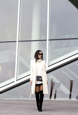 anouska proetta brandon blogger off-white winter coat knee high boots