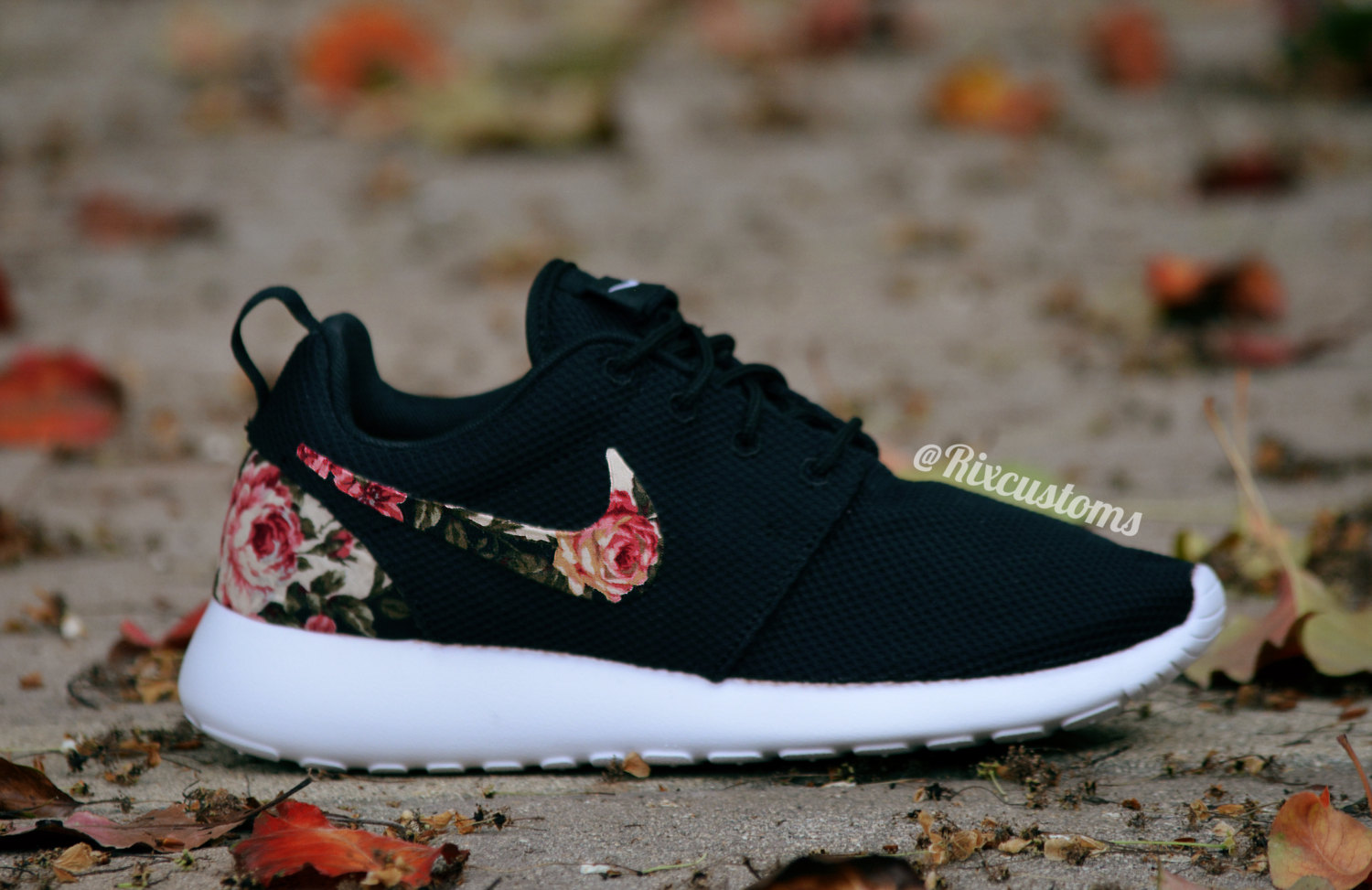 black nike roshe with floral tickets