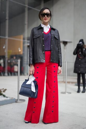 pants nyfw 2017 fashion week 2017 fashion week streetstyle red pants wide-leg pants jacket black jacket black leather jacket leather jacket bag blue bag navy sweater blue sweater shirt white shirt the chriselle factor sunglasses