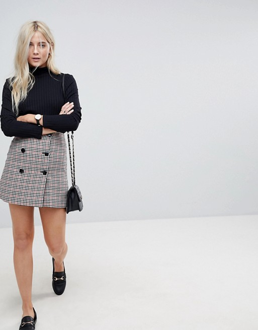 ASOS double Breasted mini skirt in check with buttons at asos.com