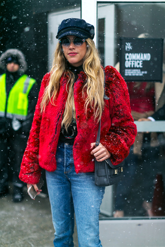 jacket nyfw 2017 fashion week 2017 fashion week streetstyle red jacket hat black hat fisherman cap denim jeans blue jeans bag black bag winter outfits winter look sunglasses round sunglasses