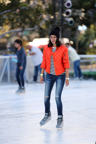 viva luxury blogger pom pom beanie stripes ripped jeans quilted red coat winter sports ice skating puffer jacket