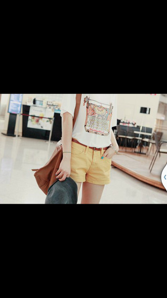 shirt typewriter shirt t-shirt white t-shirt graphic tee beige shorts short shorts black belt yellow shorts purse bag brown bag shorts