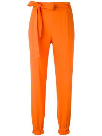 women yellow orange pants